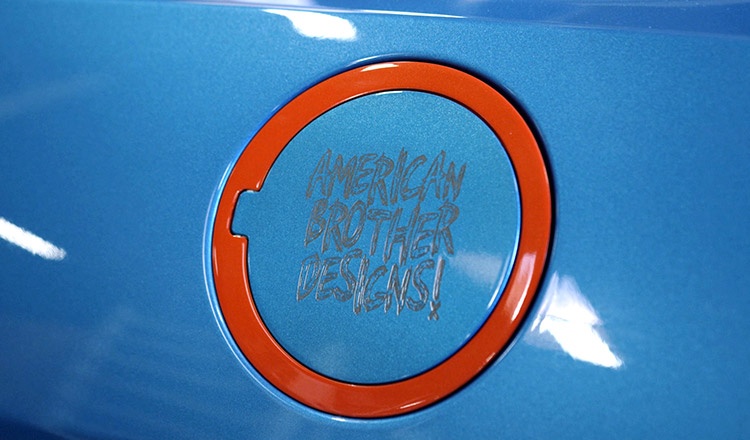 Laser engraved American Brother Designs fuel door.